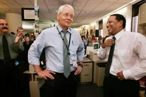 John Carroll (left) with Dean Baquet  in the newsroom of the Los Angeles Times when he announced his retirement.  ( Los Angeles Times photo)
